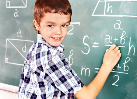 Teen school child near blackboard  in classroom. Stock Photo - 17532073