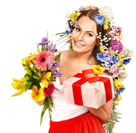 Woman with gift box and flower bouquet . Isolated. Stock Photo - 17531719