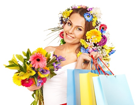 Woman with shopping bag holding flower. Isolated. Stock Photo - 17531928