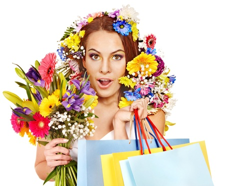 Woman with shopping bag holding flower. Isolated. Stock Photo - 17532024