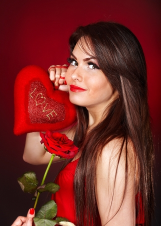 Girl holding red heart and flower rose.  Valentines day. Stock Photo - 17532915