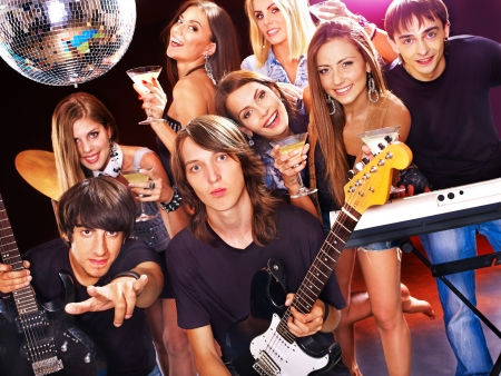 Musical group male and female  performance in night club. Stock Photo - 17572603