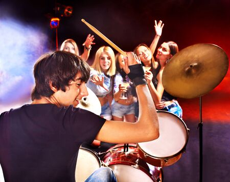 Group peole playing  guitar in night club. Stock Photo - 17532230