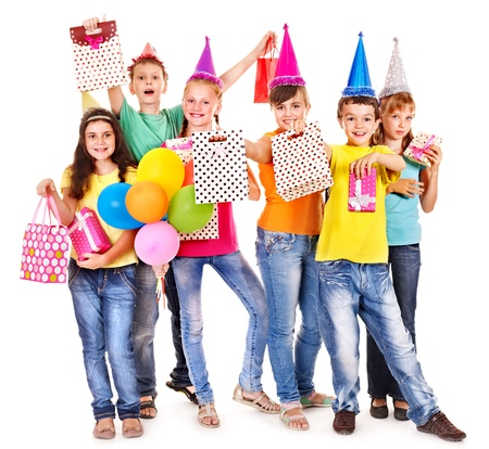 party hat: Group of teen people in party hat. Isolated. Stock Photo