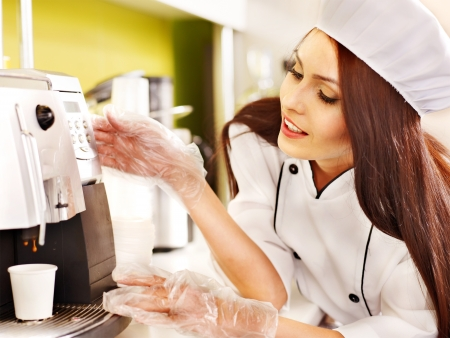 Waitresses with coffee machine at cafeteria . Stock Photo - 17531656