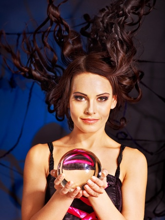 clairvoyance: Young woman  with crystal ball. Halloween.