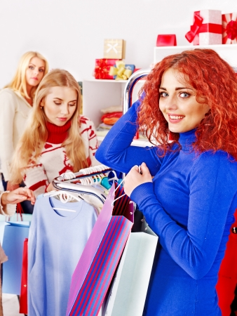 Shopping women at Christmas sales holding gift box. Stock Photo - 17532447