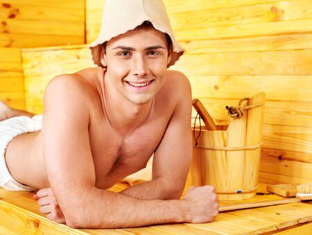 Group male people in hat  relaxing at sauna. photo