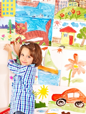 playschool: Little girl painting at  school. Education.