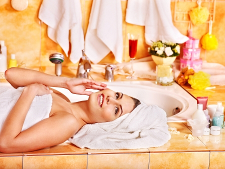 hotel bathroom: Woman relaxing at home luxury bath.