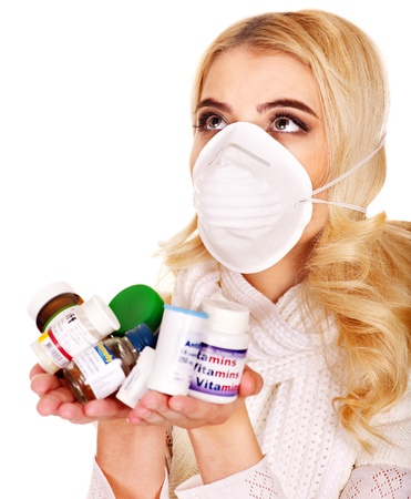 Young woman having flu takes pills. Isolated. Stock Photo - 17572385