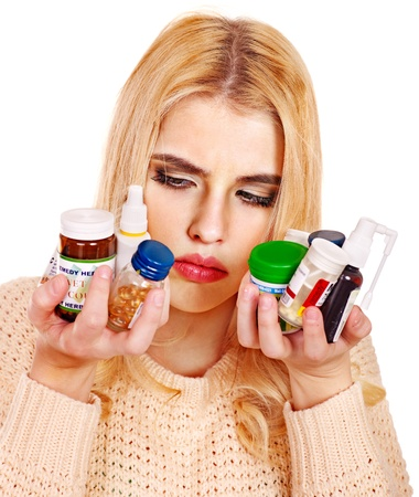 Young woman having flu takes pills. Isolated. Stock Photo - 17572618