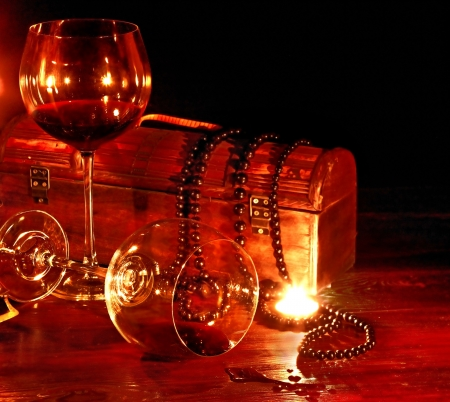Two wine glass and candle on dark. Still life. photo