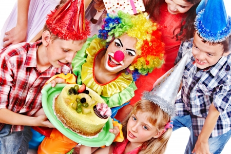 Birthday party of group teen with clown and cake. Isolated. Stock Photo - 17967773