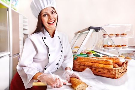 Female chef baking baguette bread Stock Photo - 17753811