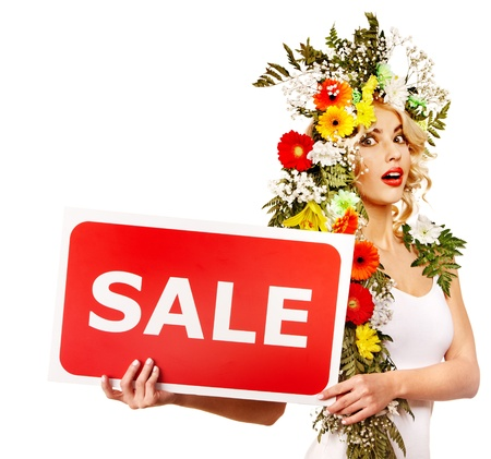 Woman holding sale banner and flower. Isolated. Stock Photo - 17753814