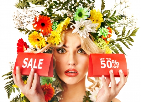 Woman holding sale banner and flower. Isolated. Stock Photo - 17753905