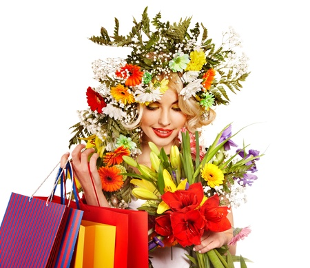 Woman with shopping bag holding flower. Isolated. Stock Photo - 17753852