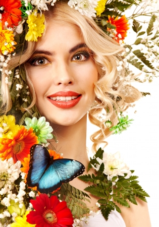 Woman with  flower and  butterfly. Isolated. Stock Photo - 17753812