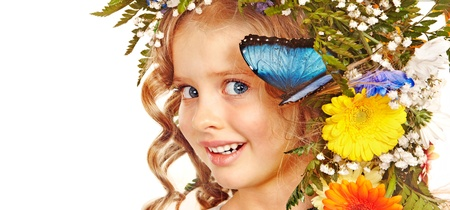 Face of child with flower and butterfly. Isolated. Stock Photo - 17753830