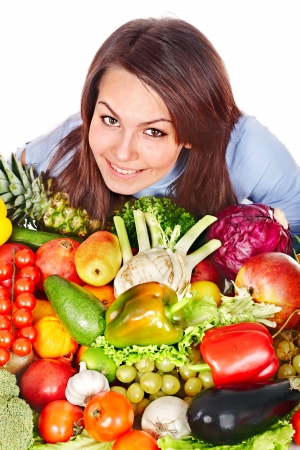 Happy woman with group of fruit and vegetables. Isolated. photo