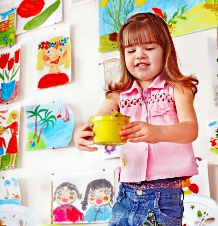 nurser: Child with paint  in art class . Preschool.