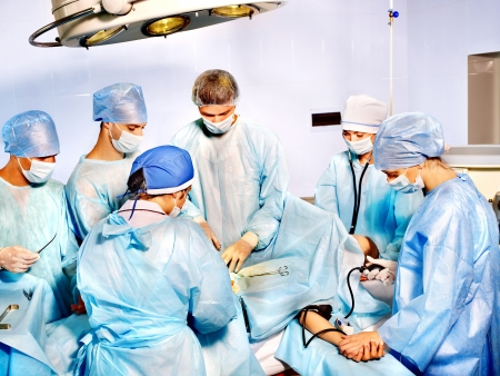 operating theater: Group of people surgeon in operating room. Stock Photo