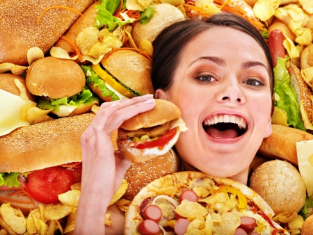 junk: Thin woman holding hamburger.