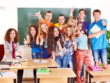 Group happy student in classroom near blackboard. Stock Photo - 17701699