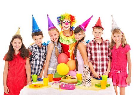 Birthday party of group teen with clown and cake. Isolated. Stock Photo - 17701732