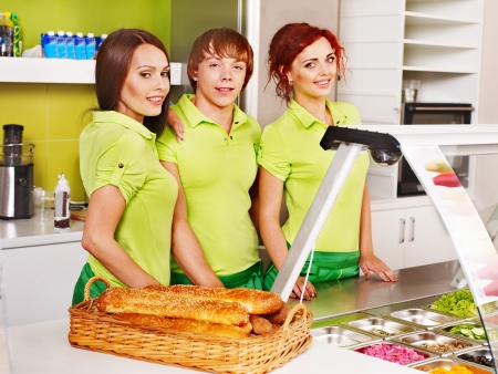 Group people selling food at cafeteria. Stock Photo - 17701666