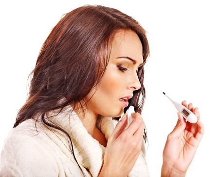 Young woman having  flue taking thermometer. Isolated. Stock Photo - 17701454