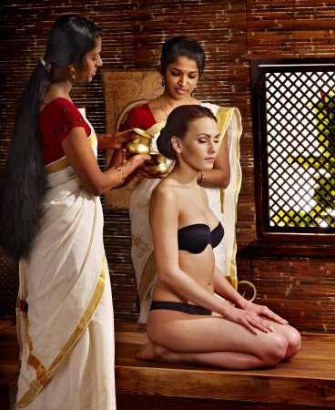 Young woman having ayurveda spa treatment. Stock Photo - 17795832