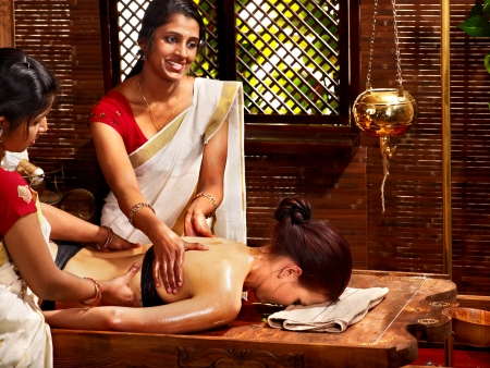 group picture: Young woman having oil Ayurveda spa treatment. Stock Photo