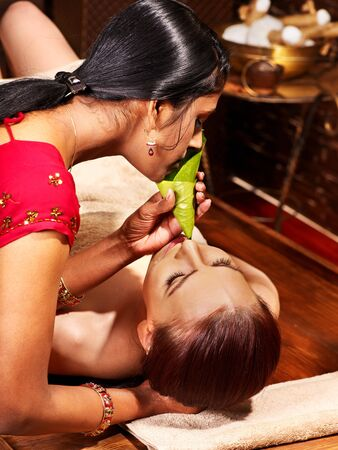 Woman having nose ayurveda spa treatment. photo