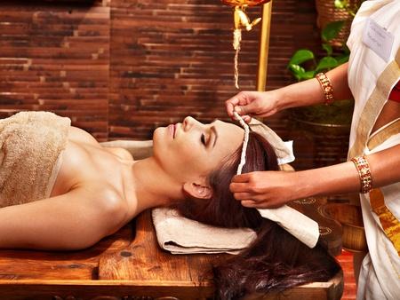 ayurveda: Woman having facial  ayurveda spa treatment.