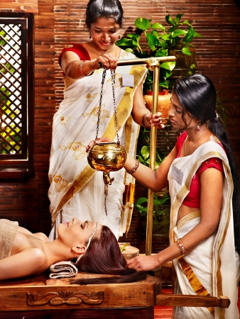 ayurvedic: Young woman having oil Ayurveda spa treatment. Stock Photo