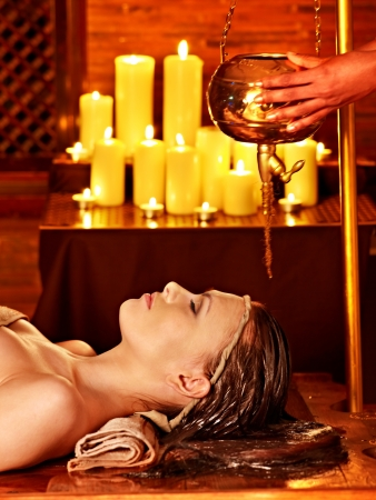 Young woman having oil Ayurveda spa treatment. Stock Photo - 17701554