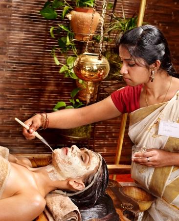 indian mask: Woman having facial mask at ayurveda spa. Stock Photo