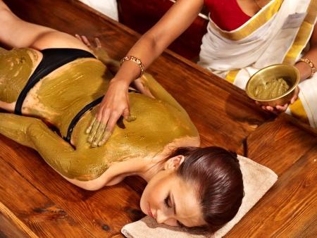 ayurveda: Young woman having body Ayurveda spa massage.
