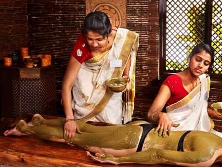 Young woman having body Ayurveda spa massage. photo
