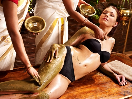 Young woman having body Ayurveda spa massage. Stock Photo - 17700475