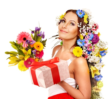 Woman with gift box and flower bouquet . Isolated. Stock Photo - 17966789