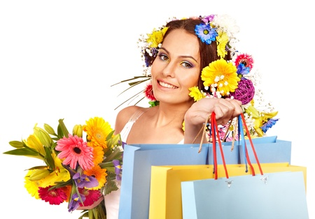 Woman with shopping bag holding flower. Isolated. Stock Photo - 17966819