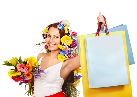 Woman with shopping bag holding flower. Isolated. Stock Photo - 17966780