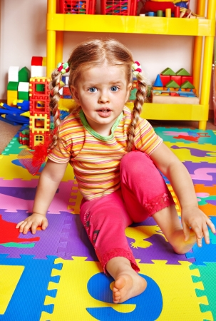 play room: Child  preschooler playing with building block .
