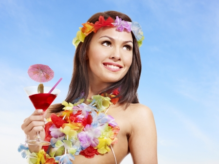 Woman in hawaii costume drink  juice. Outdoor. photo