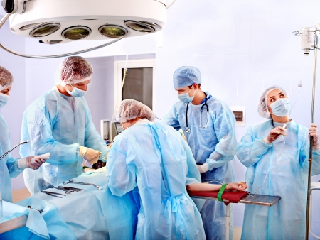 hospital interior: Team surgeon at work in operating room.