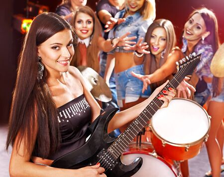 Musical group playing in night club. Male and female. Stock Photo - 17967197