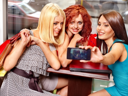 Gossip women with laptop in a cafe. photo